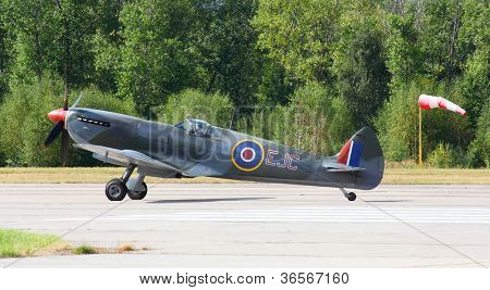 PILSEN, CZECH REPUBLIC - AUGUST 25: Most popular british fighter plane from second world war Supermarine Spitfire Mk.16, Pilsen Aeronautical Days on August 25, 2012 in Pilsen, Czech Republic.