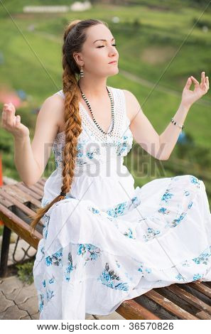 Beautiful Woman With Long Hair Meditating On  Nature Of Almaty    Young Woman Doing Yoga