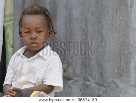 Haitian kid on doorstep.