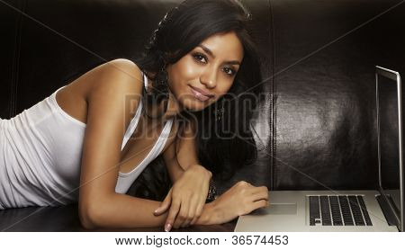 Attractive young woman working on laptop computer
