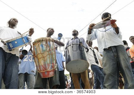 The Musicians during a funeral in Haiti.