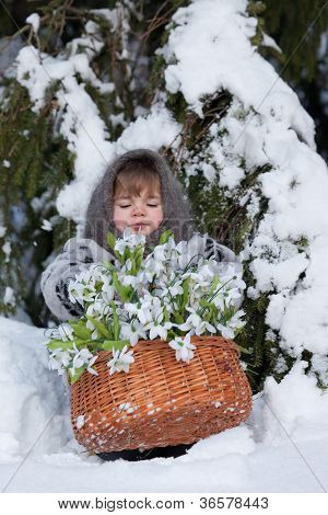 little girl in a winter wood