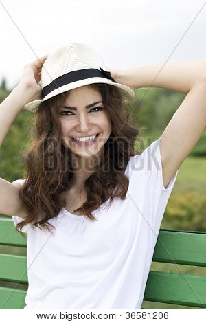Sitting on a bench girl smiling