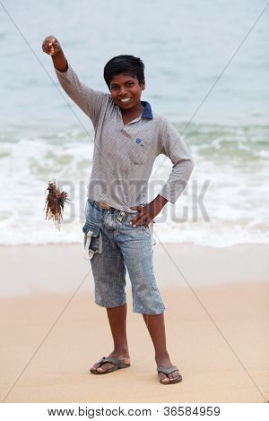 Indian boy with lionfish