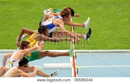 BARCELONA - JULY 10: Competitors of 110 meters hurdles during the 20th World Junior Athletics Championships at the Olympic Stadium on July 10, 2012 in Barcelona, Spain