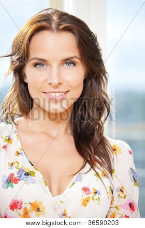 bright picture of happy woman at the window