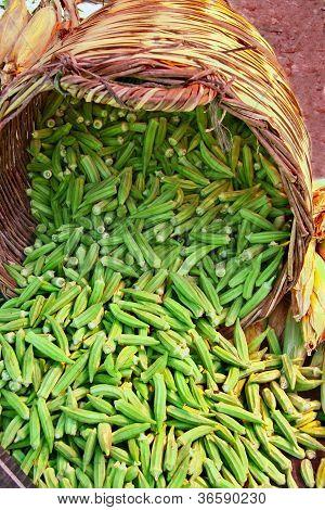 Organic Okra Spilling From A Basket