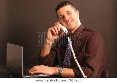 Man On Phone While On Computer 2431