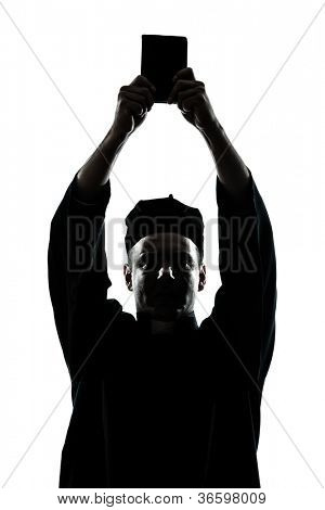 one caucasian man priest wrath of god  silhouette in studio isolated on white background