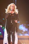 MOSCOW - DEC 17: Bonnie Tyler sing on scene during concert of Legend RetroFM in Sports complex Olimp
