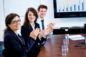 Businesspeople Clapping On Training