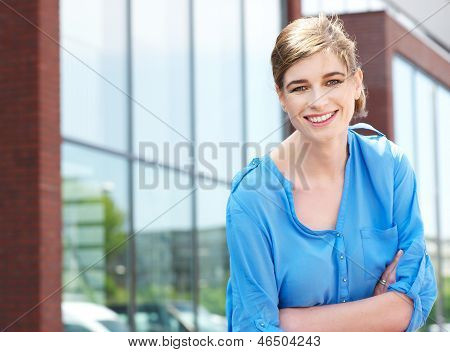 Casual Business Woman Relaxing Outside Of The Office And Smiling