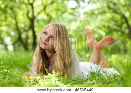 Young Woman On The Grass