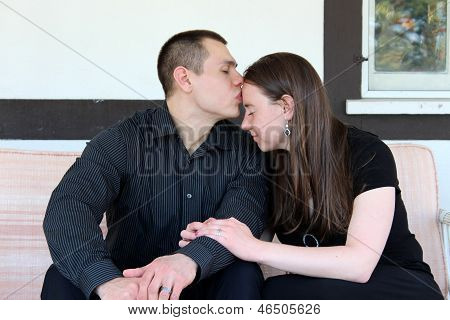 Young married couple sharing an intimate moment