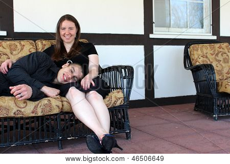 Young handsome man lying in wife's lap
