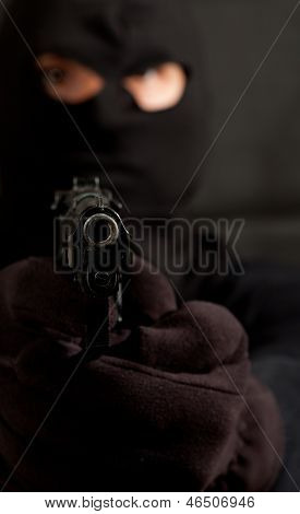 Hooded Robber With A Gun