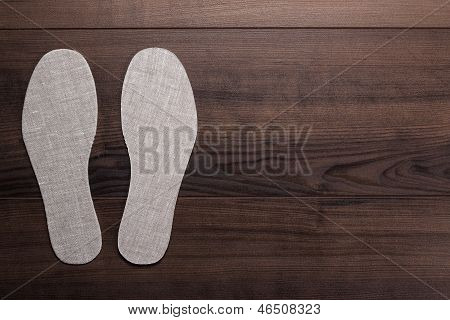 insoles for shoes on wooden background