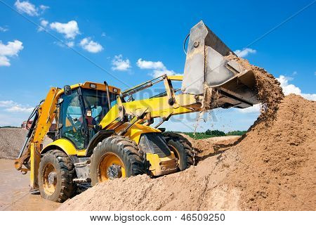 Excavator machine unloading sand with water