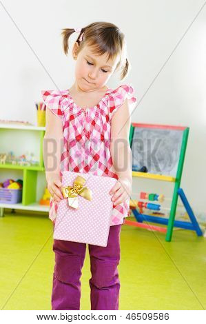 Cute Constrained Girl With Present Box