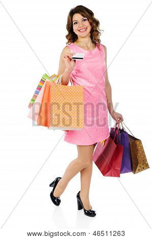 Beautiful Woman With Credit Card And Shopping Bags Isolated On White