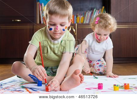 Two Cute Kids Painting