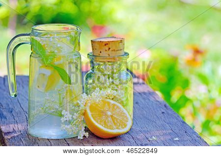 Elderflower and lemon juice shoot in garden