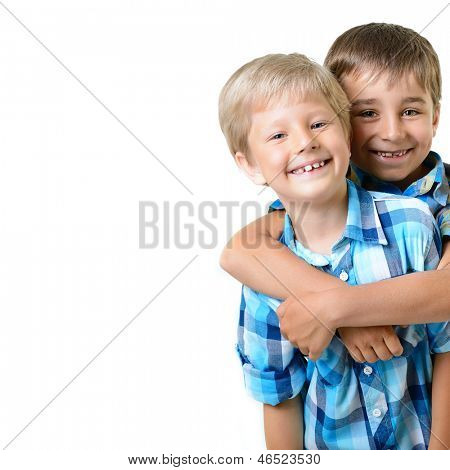 portrait of two happy little boys friends in blue checked shirts isolated on a white background
