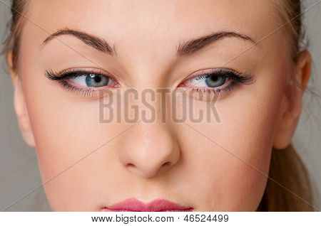 Close up portrait of beautiful young woman with blue eyes
