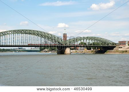 A Train Crosses The Hohenzollernbruecke Over The Rhine In Cologne