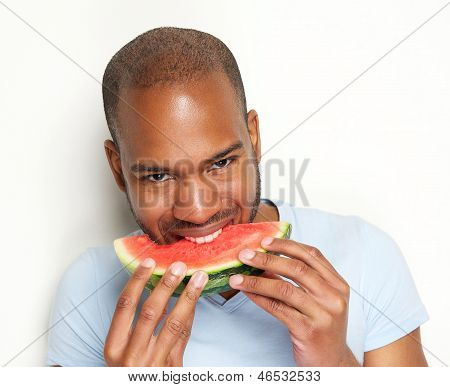 Young Man Smiling And Eating Delicious Watermelon