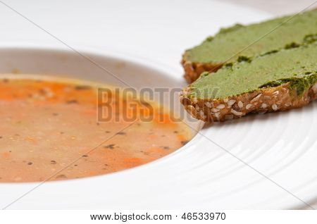 Italian Minestrone Soup With Pesto Crostini On Side