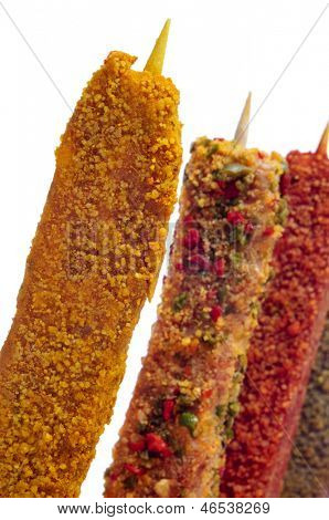 closeup of some raw turkish spiced chicken meat skewers, on a white background