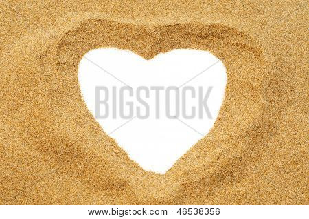 a heart drawn in the sand, with a blank space, as a heart-shaped frame