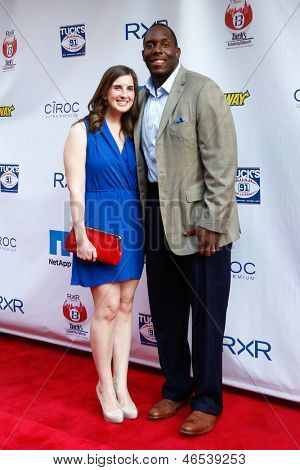 NEW YORK-MAY 30: New York Giants player Kevin Boothe and wife Rosalie attend the 5th annual Tuck's Celebrity Billiards Tournament at Slate NYC on May 30, 2013 in New York City.
