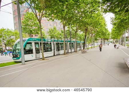 People Walking In The Morning To The Work And A Tram Passing In Diagonal Avenue, In Barcelona, Spain