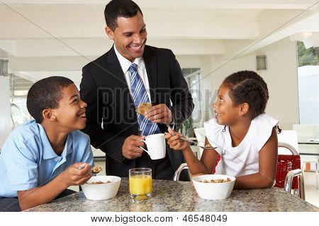 Father Having Breakfast With Children Before Work