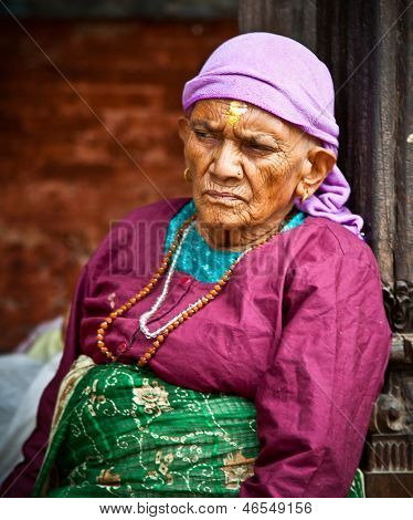 KATHMANDU, NEPAL - MAY 18 - Old woman sit in the retirement home founded by Mother Teresa in Rajrajeshwari Temple near Pashupatinath Temple, Kathmandu, Nepal on May 18, 2013