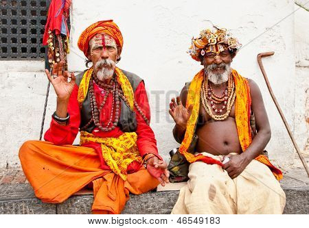 KATHMANDU, NEPAL - MAY 18: Holy Sadhu men with traditional painted face, blessing in Pashupatinath Temple. May 18, 2013 in Kathmandu, Nepal.