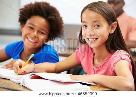 Pupils Studying At Desks In Classroom
