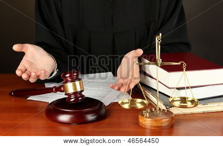 Judge sitting at table during court hearings on black background