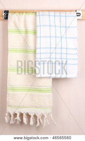 Bath towels on crossbar in room