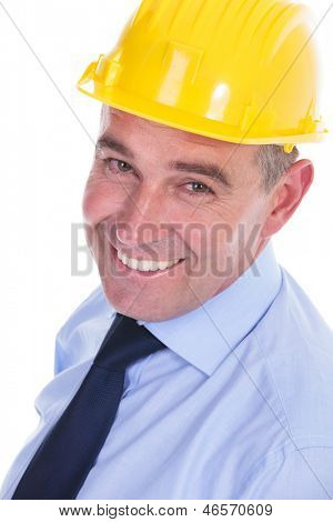 closeup portrait of a senior engineer looking at the camera with a big smile on his face. isolated on white background