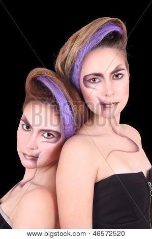 Portrait Of Two Beautiful Girls Twins