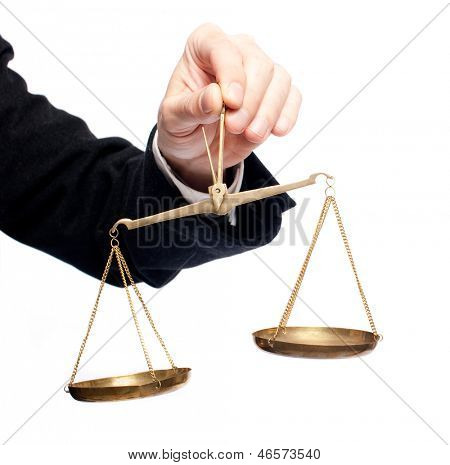businessman hand holding a balance on white background