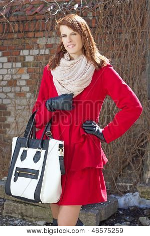 Young Attractive Woman In Red Over Brick Wall
