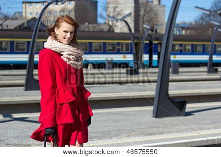 Woman Waiting Train On The Platform Of Railway Station