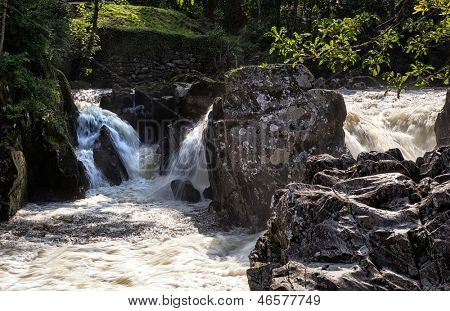 Waterfalls and river running through Betws-y-Coed, Snowdonia, North Wales