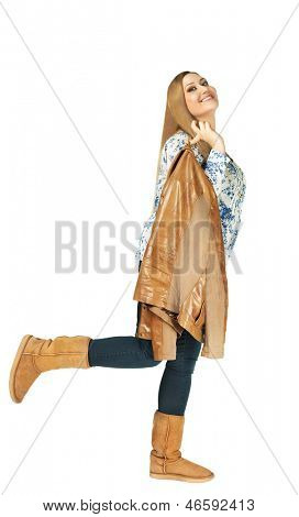 Charming xxl woman smiling and holding a jacket on white background