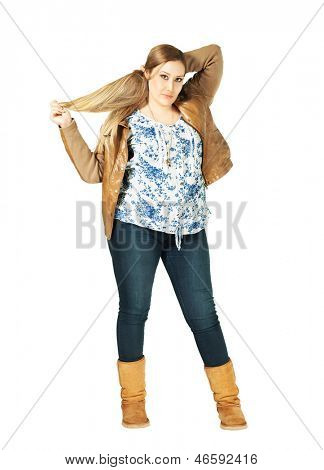 Charming xxl woman looking ate camera on white background playing with hair