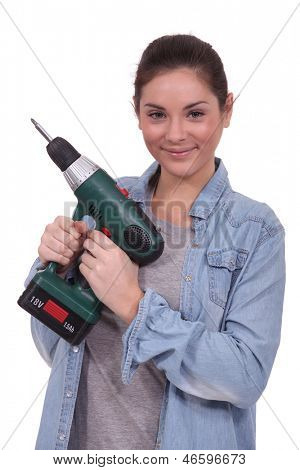 craftswoman holding a drill